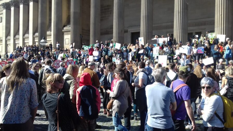 Crowd of climate protesters in Liverpool